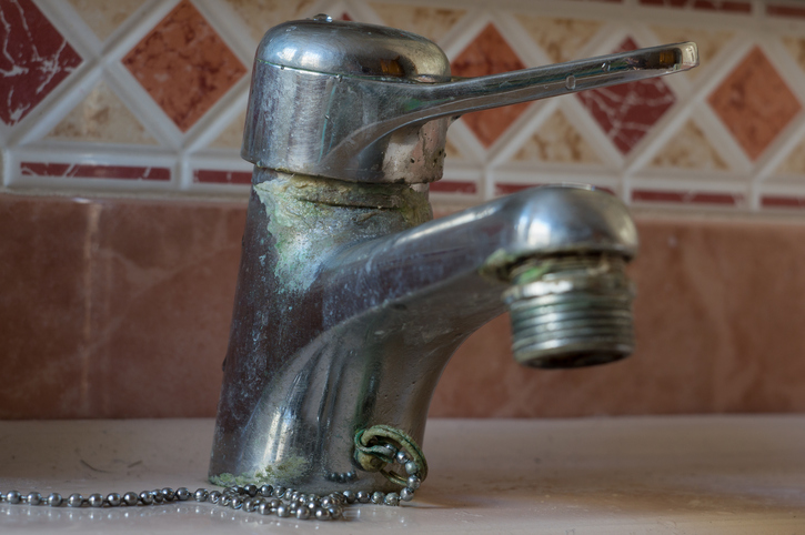 Water tap with limescale, soiled bathroom faucet